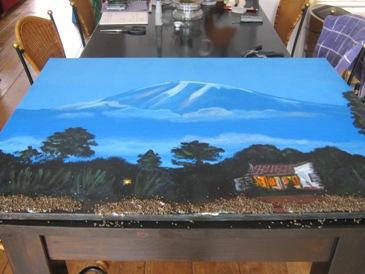 de Kilimanjaro ligt op de tafel